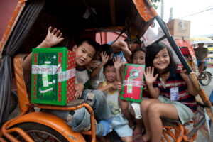 Children receiving Christmas gifts