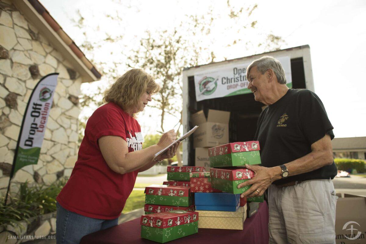 Volunteers loading Shoebox Christmas gifts in Orange County, CA