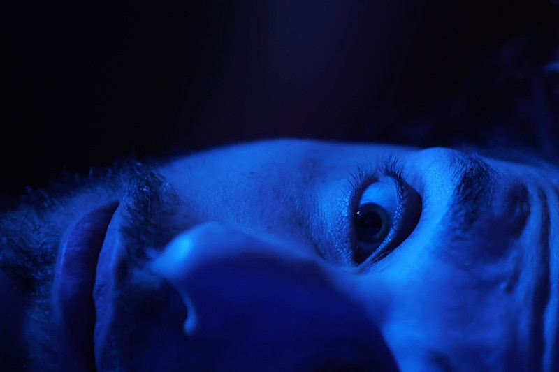 Man in blue light